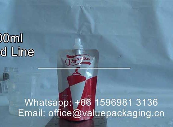 filled-line-100ml-chilli-sauce-screw-cap-doypack